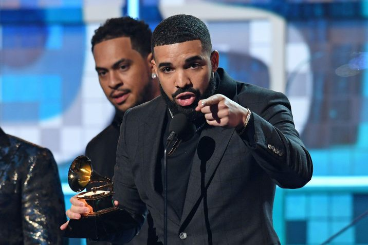 """FILE: Canadian rapper Drake accepts the award for Best Rap Song for """"Gods Plan"""" during the 61st Annual Grammy Awards on Feb. 10, 2019, in Los Angeles."""