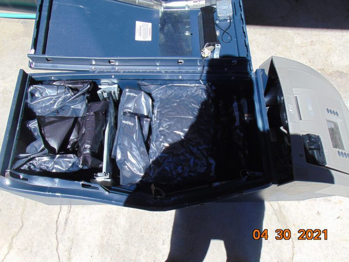 A vehicle search revealed a plastic tote containing packages of cannabis, the safe and more than a dozen ATMs. /